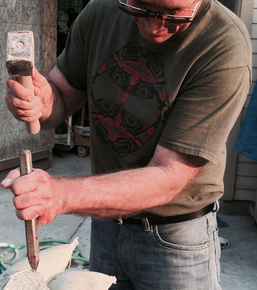 Note his grip on the chisel.  More control.